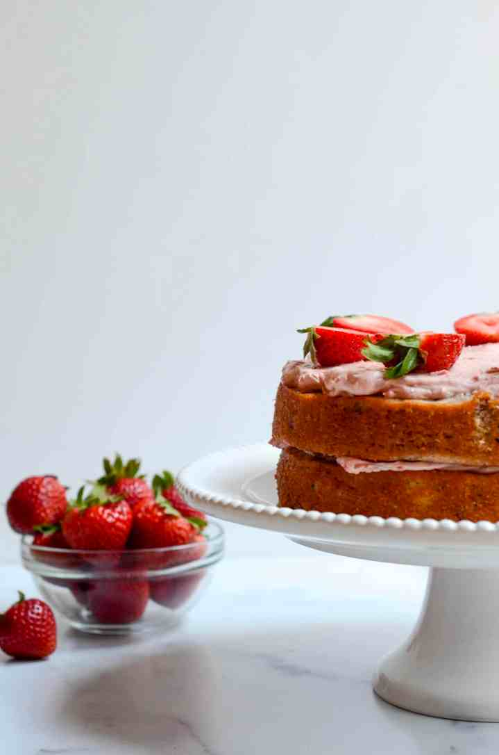 strawberries next to naked strawberry cake