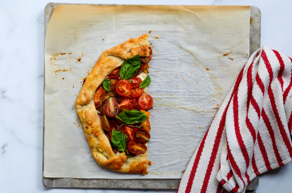 half of a goat cheese and tomato tart