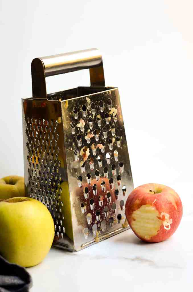 you'll grate apples with a cheese grater.  i like to use the thickest setting.