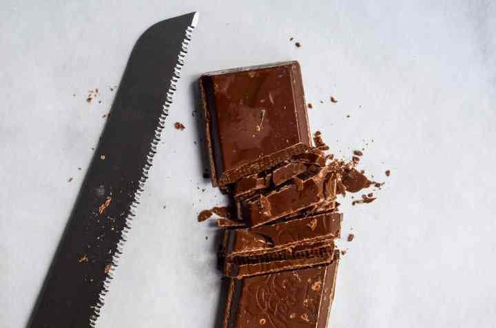 cut chocolate bar with serrated knife for pools of chocolate on your cookies