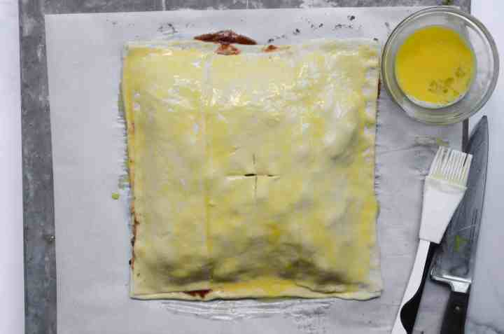 egg wash goes on top of the puff pastry to make sure it browns nicely