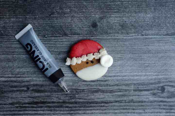 use a marshmallow for the poof of santa's hat and a tube of black cookie icing to make the eyes