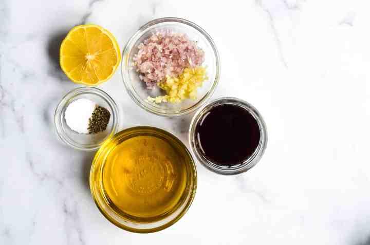 ingredients needed for the sherry shallot vinaigrette: olive oil, sherry vinegar, shallot, garlic, lemon juice, honey, salt and pepper.