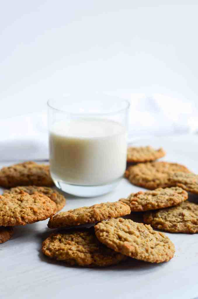 oatmeal buttescotch cookies around a glass of milk