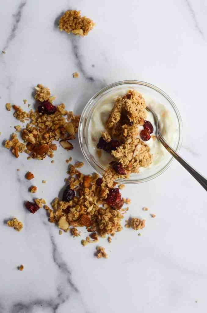 healthy homemade granola on top of a bowl of yogurt