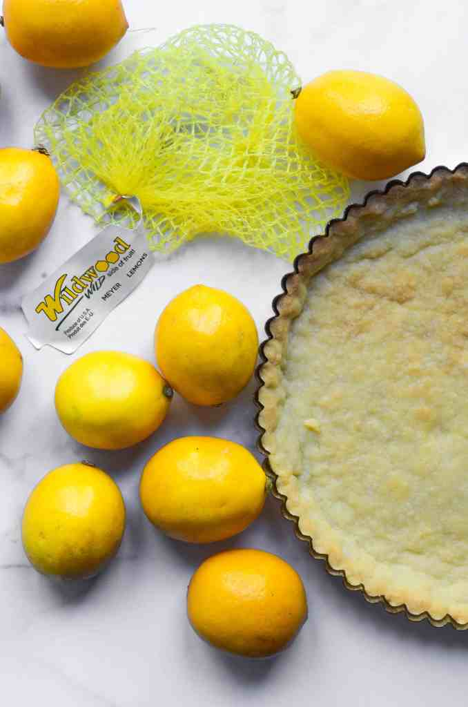 meyer lemons around the baked shortbread crust