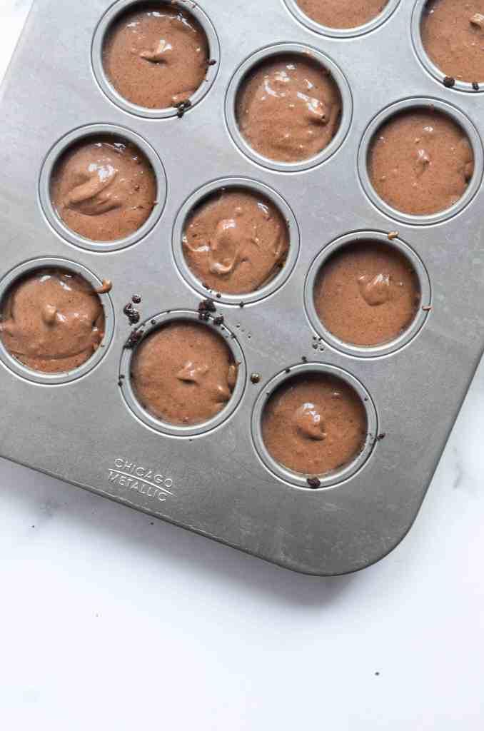 chocolate cheesecake mixture poured into cheesecake pan ready to bake