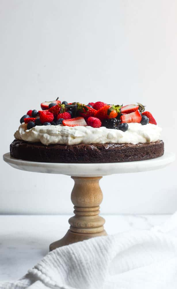 side view of brownie pizza cake on cake plate