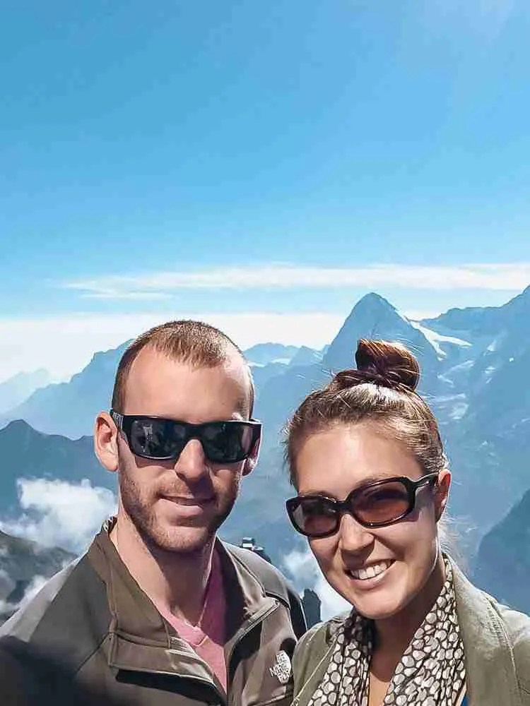 Couple smiling with backdrop of Swiss Alps