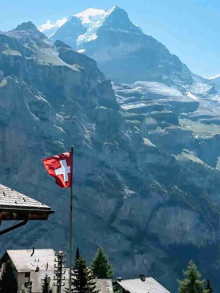 Swiss flag high in the Swiss Alps