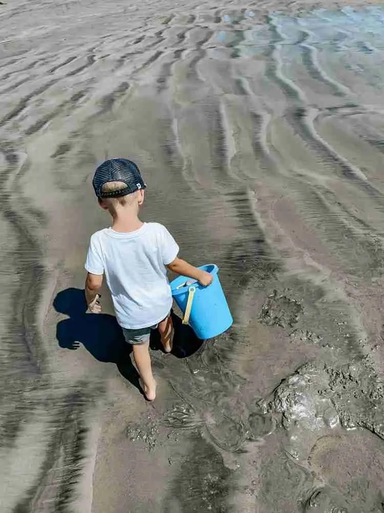 Travel with kids so they can explore on the sandy beach