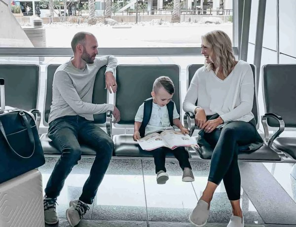 Travel with kids at the airport waiting for your flight