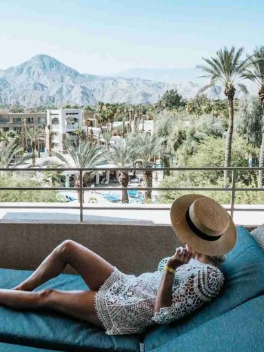 Woman lounging on balcony in Palm Springs