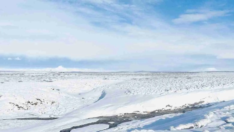 Snowy landscape in Iceland with blue sky
