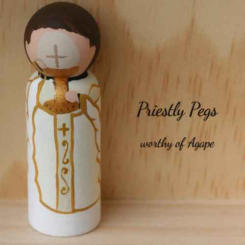 Priestly pegs white vestment host face