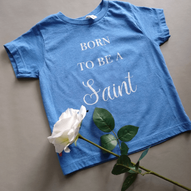born to be a saint blue flatlay