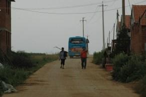A Bus & A Pair of Farmers