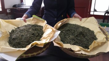 Different qualities of tea leaves after they've been dried.