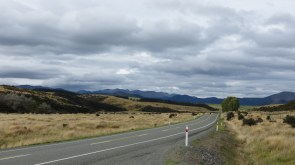 SH94 is one long flat drive through dry tussock lands.