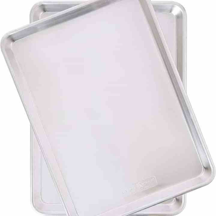 two aluminum baking pans against a white background
