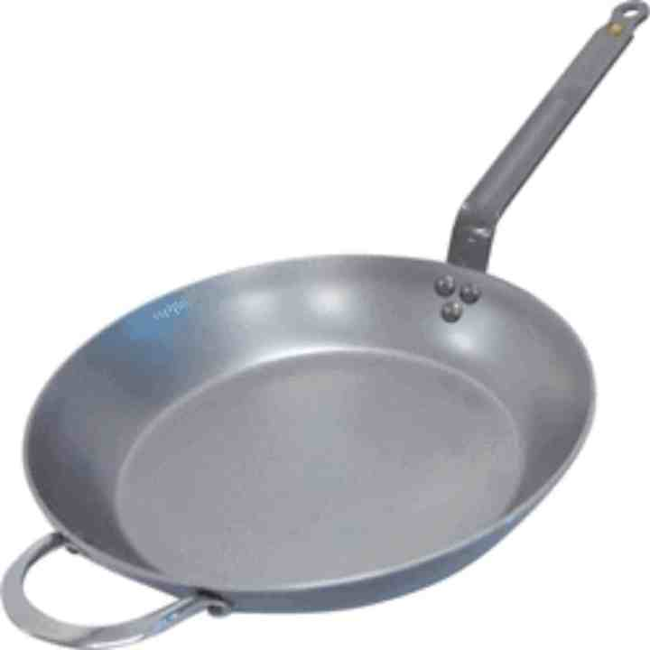 carbon steel pan against a white background