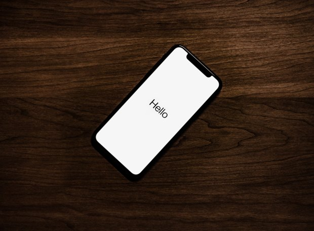 iPhone with the word 'Hello' on the screen
