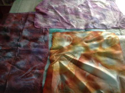 Jill Hill. I have some pressure stencilled silk samples and a piece of vilene. I think I shall go with the orangey one and am currently doing another piece of vilene in stronger turquoise hues. I thought to use heat treated copper shim for the fiery bits.