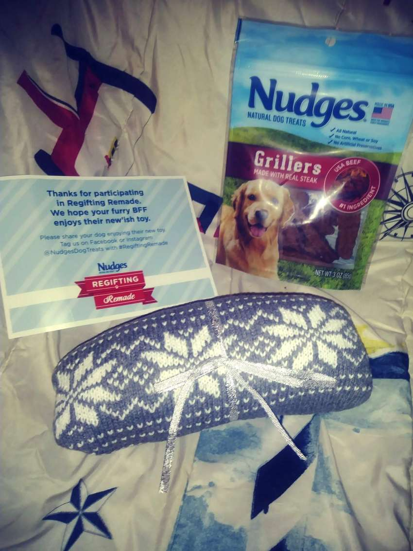 Nudges dog treats and toy