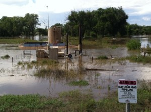 Near the Cache La Poudre River, this is one of many oil and gas wells in northeast Colorado submerged in the flooding.