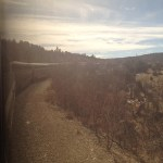 Looking out the window as Amtrak's Southwest Chief rounds a bend.