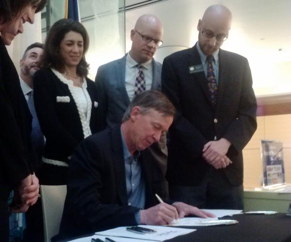 Governor John Hickenlooper signs House Bill 1361 to create an equivalency between marijuana that is smoked, and marijuana in a concentrate form that is vaporized.