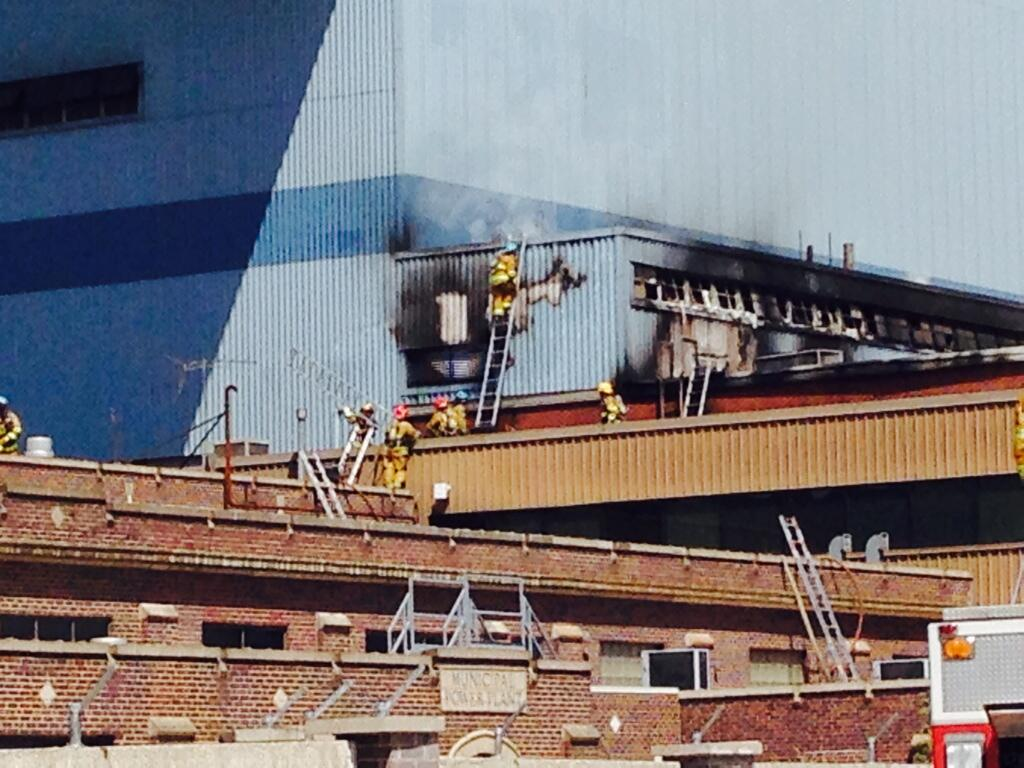 Colorado Springs firefighters work on a blaze at the Martin Drake Power Plant
