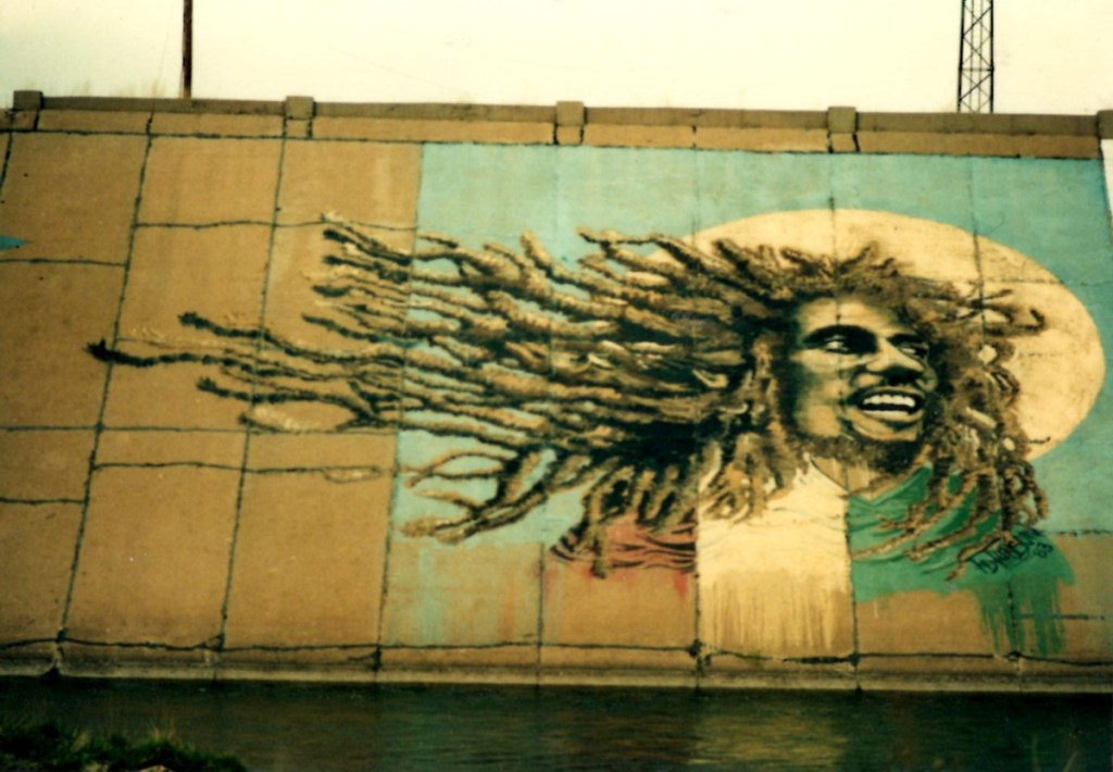 An older photo of Bob Marley painted on Pueblo's Arkansas River levee mural.