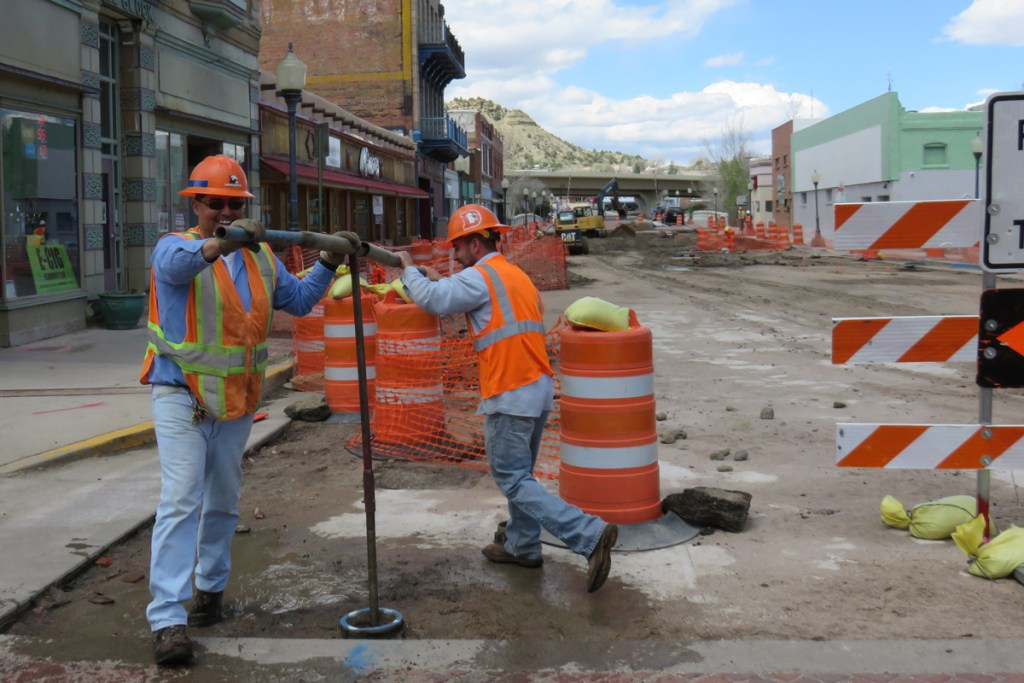 Workers look to rehab the red brick streets in this contraction area in downtown Trinidad. Trinidad is counting on severance tax funds to help with the downtown redevelopment.