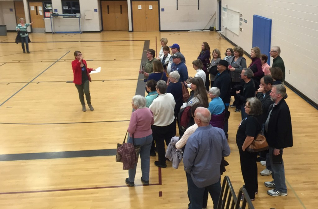 Caucus-goers line up in support of Democratic presidential candidate Hillary Clinton