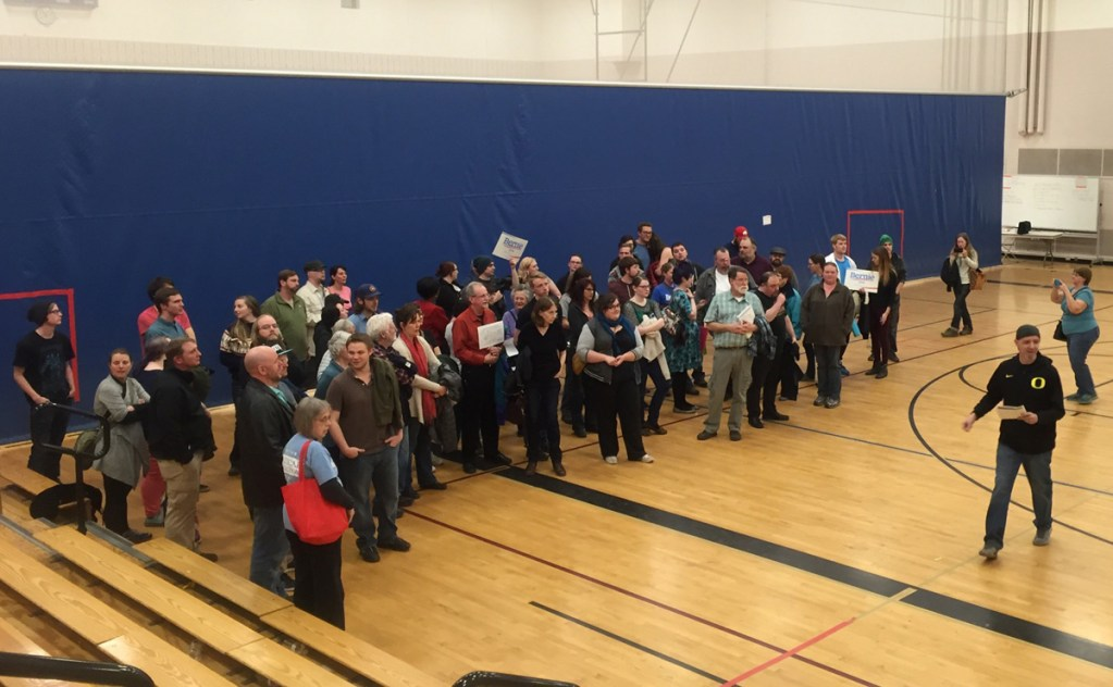 Caucus-goers line up in support of Democratic presidential candidate Bernie Sanders