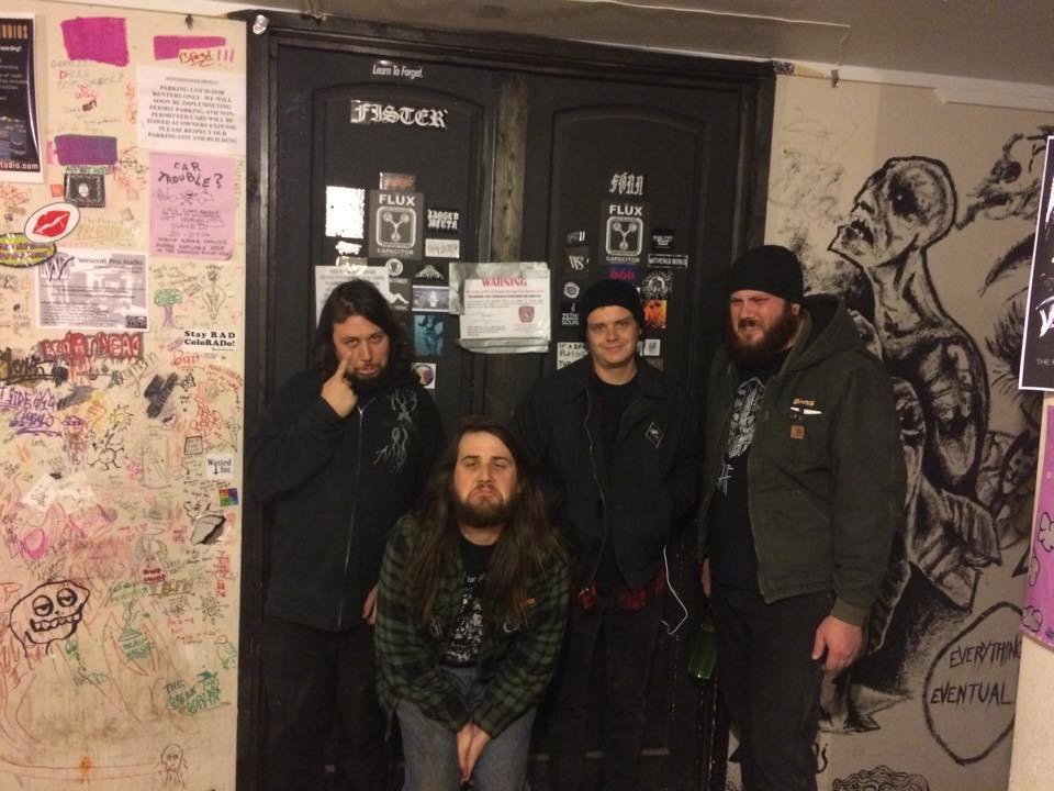 Flux Capacitor co-founders pose beside a code violation notice on the door to the venue.