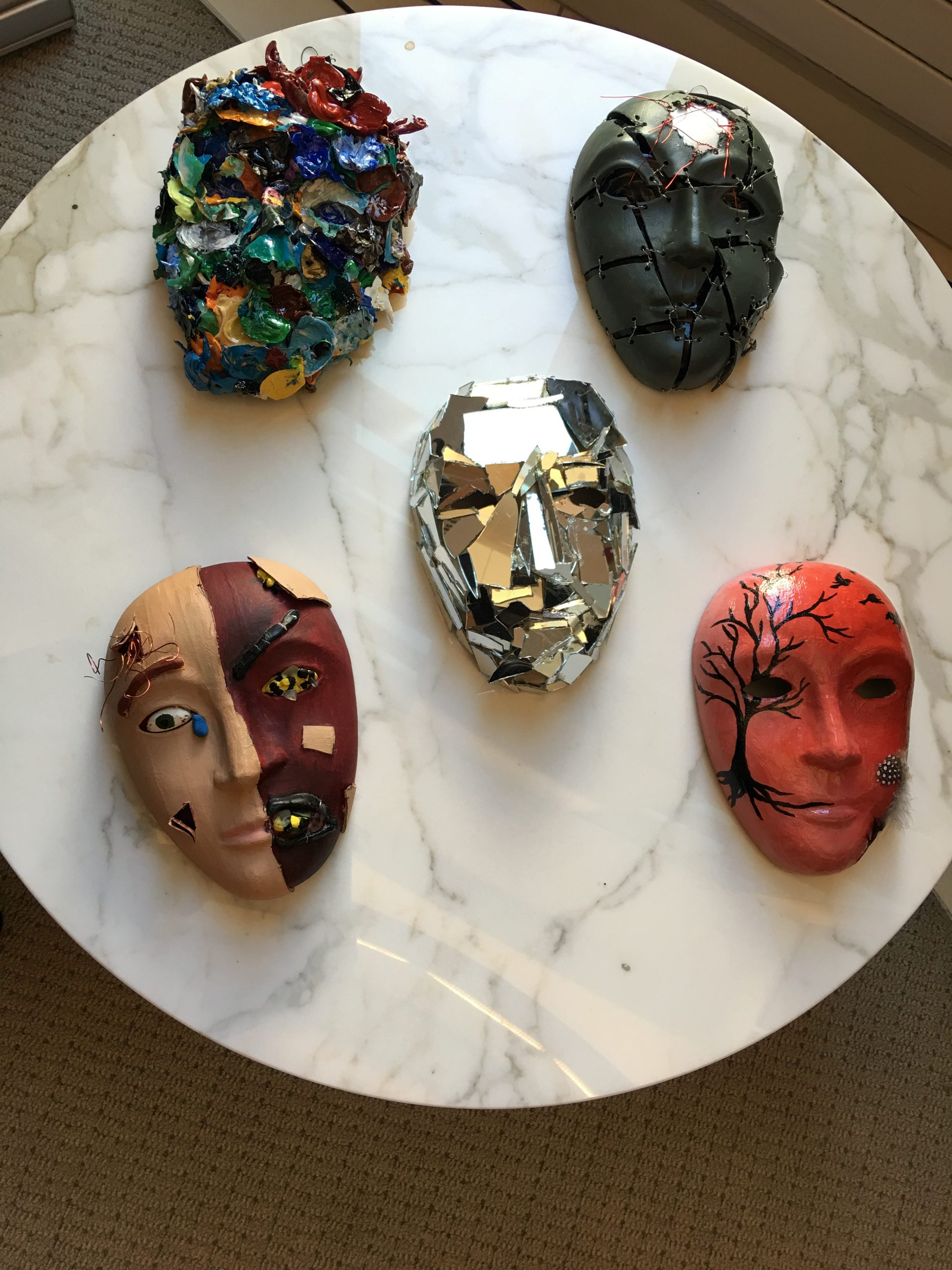 Masks are displayed, decorated by service men and women as part of the Creative Forces: NEA Military Healing Arts Network at the National Intrepid Center of Excellence