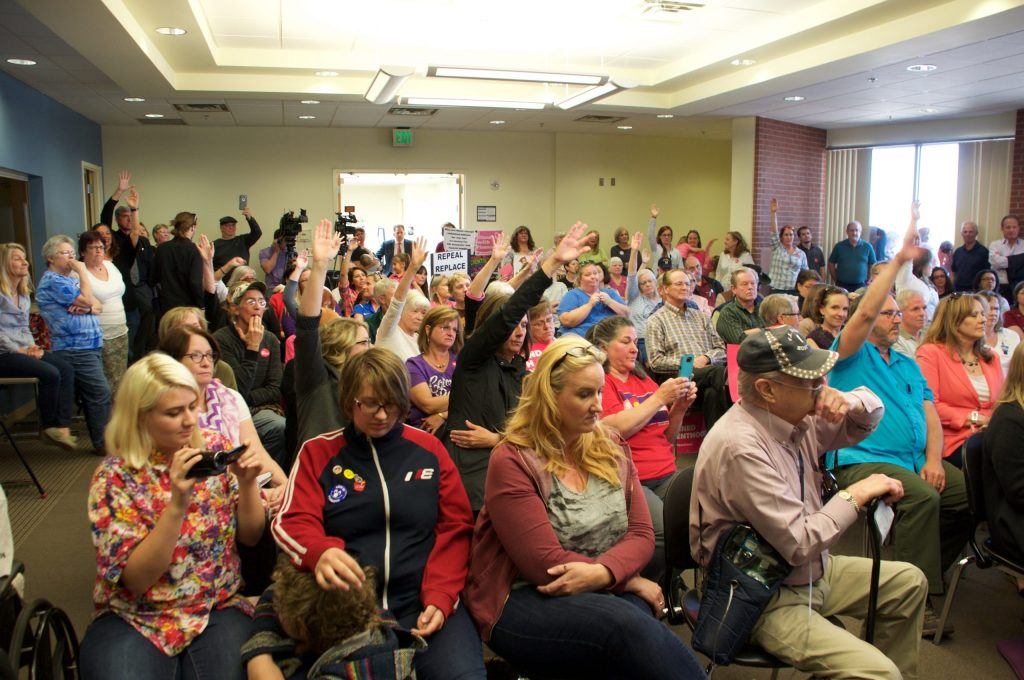 Constituents wait to be called upon during the town hall meeting.