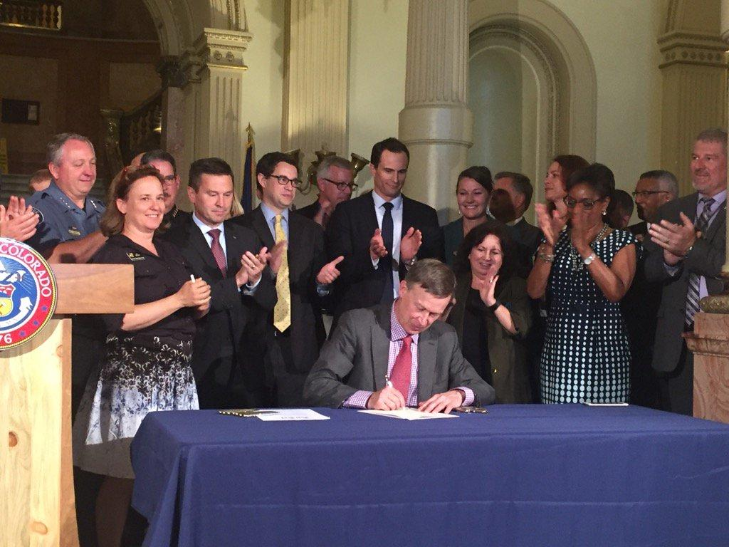 Gov. John Hickenlooper signing House Bill 1220 and 1221 , which target large-scale, non-commercial marijuana grows.