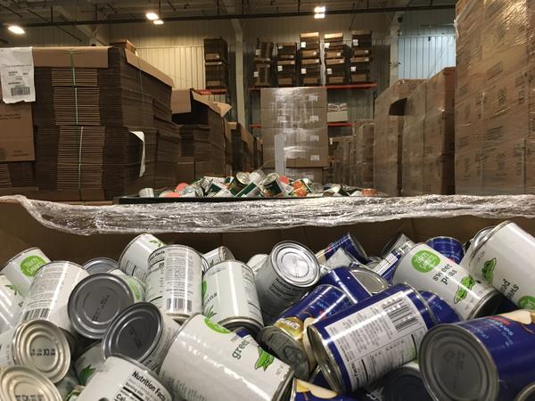 Bins of food wait to be sorted at Harvesters' warehouse in Kansas City, Missouri. It's a food bank that distributes to food pantries in 16 Kansas counties and 10 Missouri counties, according to Chief Resource Officer Joanna Seblien.