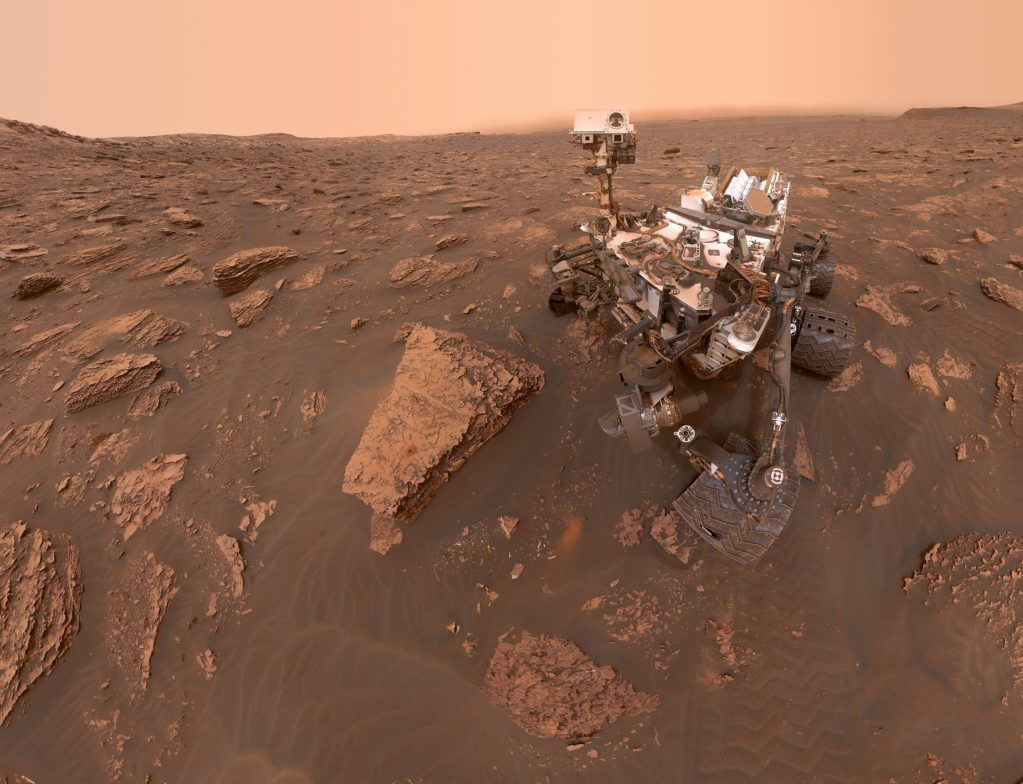"""A self-portrait of NASA's Curiosity Mars rover shows the robot at a drilled sample site called """"Duluth"""" on the lower slopes of Mount Sharp. A Martian dust storm reduced sunlight and visibility in Gale Crater."""