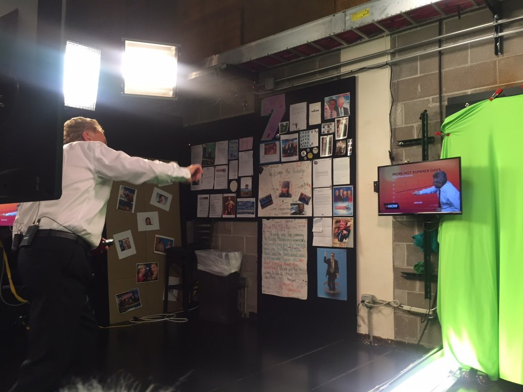 Denver meteorologist, Mike Nelson, doing his weathercast
