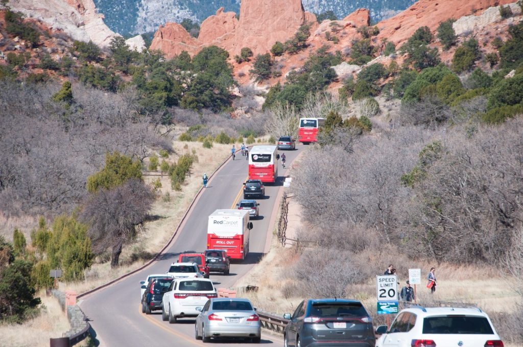 Vehicles file into Garden of the Gods after the end of the first Motorless Morning in April 2018. File photo.
