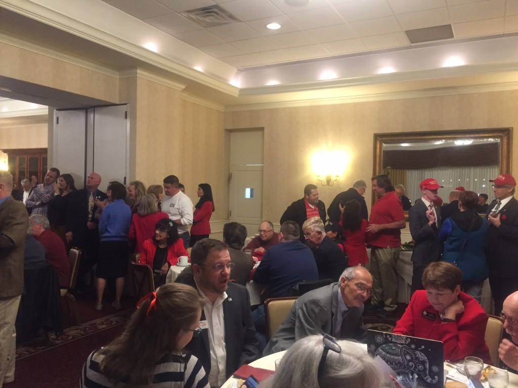 Red shirts and hats were a theme at the GOP watch party at the Colorado Springs Country Club