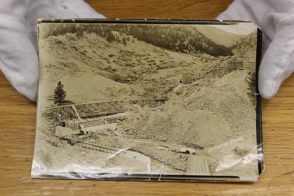 A photo in the Longmont Museum's archive shows Chimney Rock Dam mid-construction.