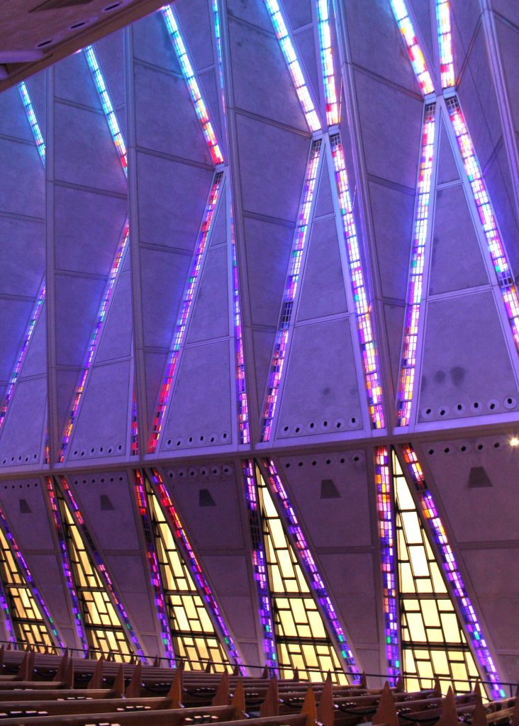 The Cadet Chapel at the United States Air Force Academy is made up of 100 identical tetrahedrons with mosaic ribbon glass in between, pictured here.