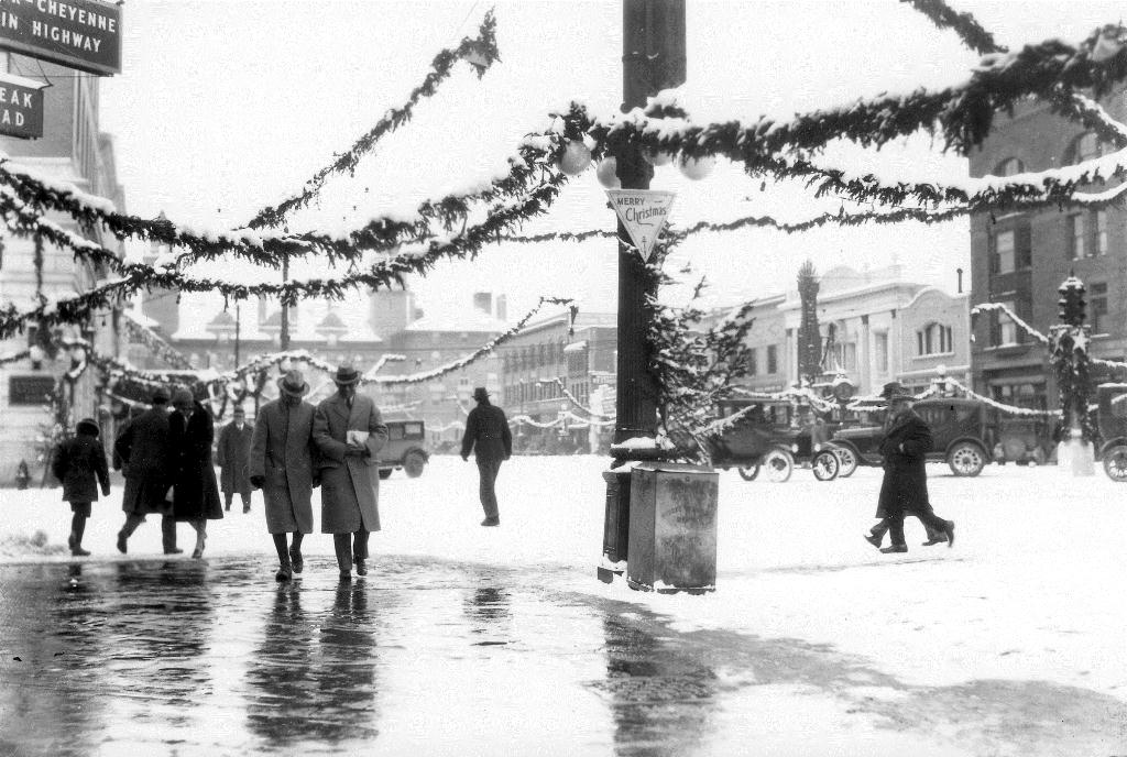 <p><strong>Colorado Springs, 1926.</strong>Pedestrians walk on Pikes Peak Avenue shortly before Christmas.</p>