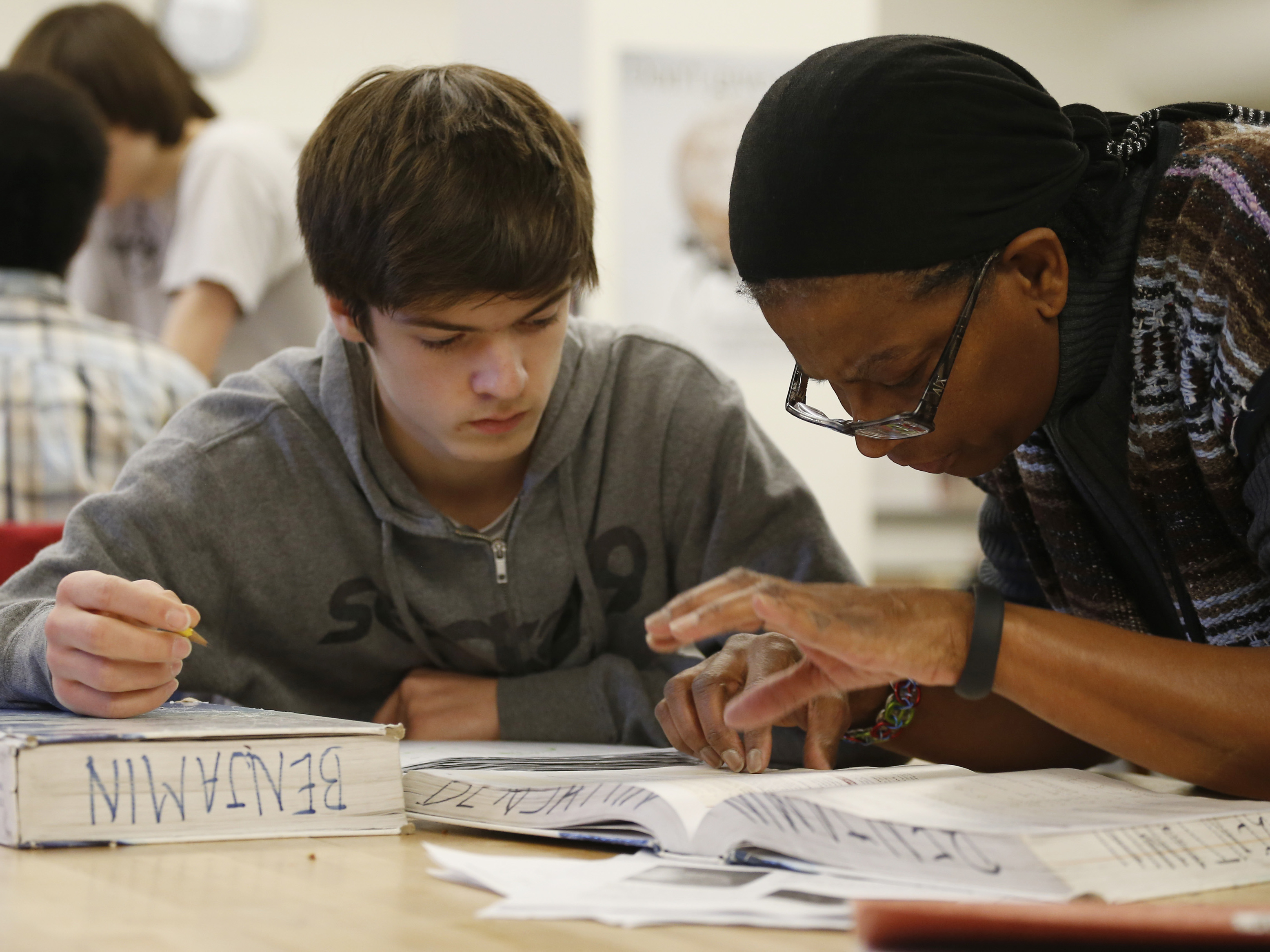 <p>Student James Montalbano works with teacher Angela Benjamin on a Advanced Placement class in a file photo.</p>