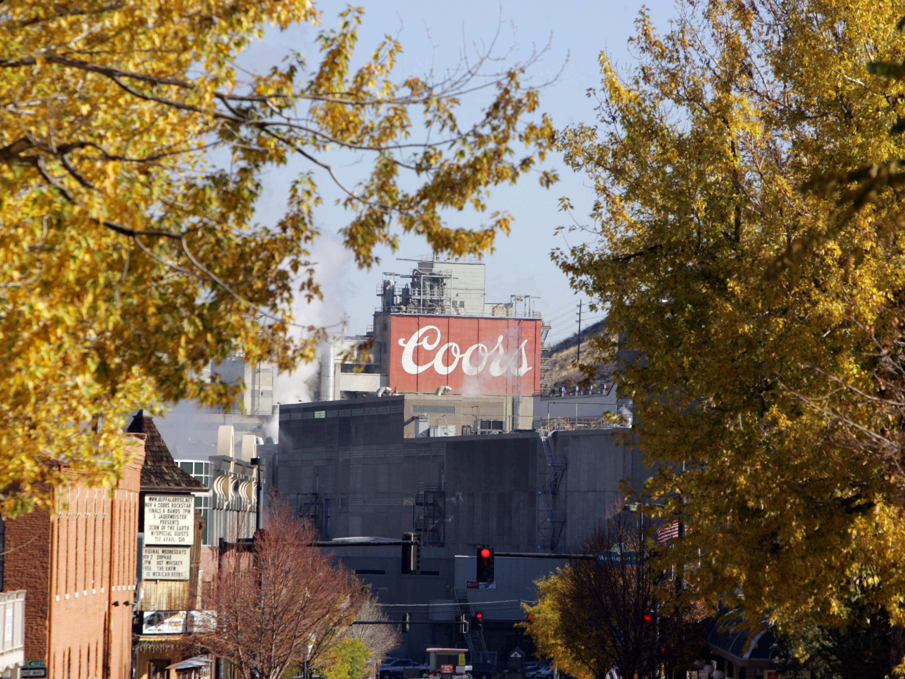 <p>The Coors brewery is framed by golden Aspen leaves in Golden, Colo.</p>